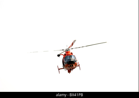 High resolution photograph of a red helicopter isolated on white - Stock Photo