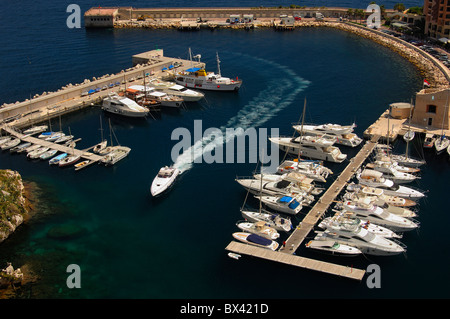 White motor-yard entering the Marina of Fontvielle at the Mediterrenean Sea, Principality of Monaco - Stock Photo
