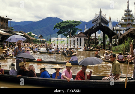 Intha people on boats at the Yumana Floating Market on Inle Lake, Nyaungshwe Township, Taunggyi District, Shan State, - Stock Photo