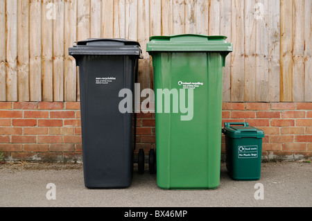 Chipped Recycling and Rubbish Bins Outside a Residential Property, Oxfordshire, United Kingdom. - Stock Photo