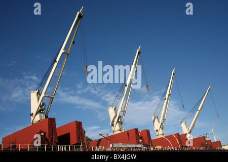 Cranes On The Cargo Ship 'Stellar Eagle', Liverpool Docks, UK - Stock Photo