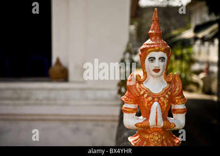 A small painted statue at Wat Buppharam in Chiang Mai in Thailand - Stock Photo