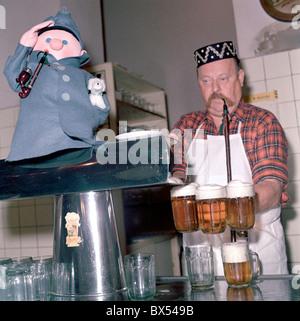 innkeeper, landlord, bartender, draught draft tap beer, glass, pipe, cap, pub, restaurant U Kalicha, Svejk - Stock Photo