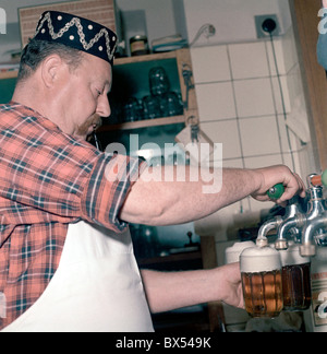 innkeeper, landlord, bartender, draught draft tap beer, glass, pipe, cap, pub, restaurant U Kalicha, Svejk - Stock Photo