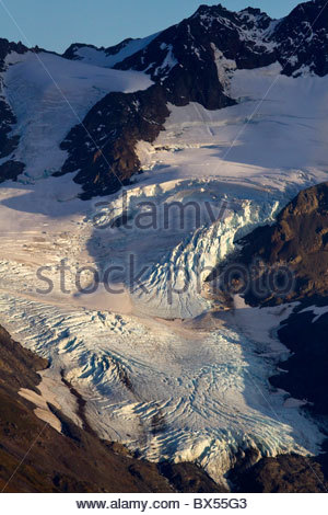 Alaska. Early evening light on a hanging glacier south of Exit Glacier on the edge of the Harding Ice Field, Kenai - Stock Photo