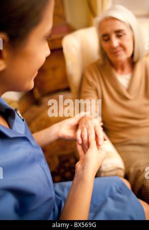 Nurse on a home visit - Stock Photo