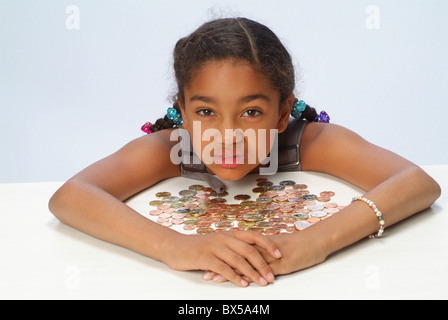 A girl with her savings - Stock Photo