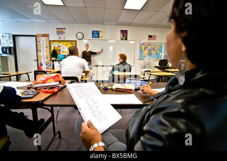 A community adult basic literacy class meets in San Juan Capistrano, California. Note list in student hand in foreground. - Stock Photo