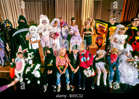 Children are dressed in Halloween costumes at a San Clemente California costume competition. - Stock Photo