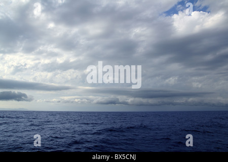 cloudy stormy day in the blue ocean sea seascape - Stock Photo