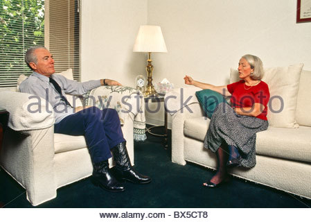 A psychotherapist converses with a patient at his office in Southern California. - Stock Photo