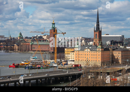 Aerial view on central Stockholm. The building on the left is the City Hall, on the right is the famous Riddarholmen - Stock Photo