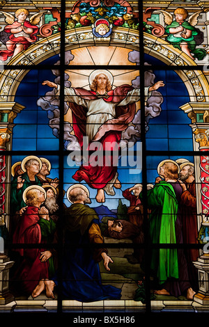 Beautiful stained glass window created by F. Zettler at the German Church in Gamla Stan in Stockholm. - Stock Photo