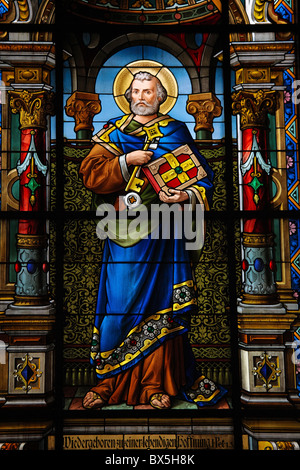 Saint Peter. Stained glass window created by F. Zettler (1878-1911) at the German Church (St. Gertrude's church) - Stock Photo