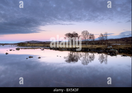 Evening view over flat calm Loch Ba, Rannoch Moor, near Fort William, Highland, Scotland, UK