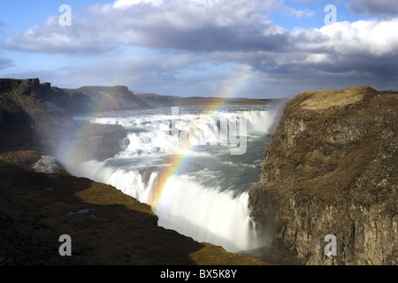 Gullfoss, Europe's biggest waterfall, with rainbow created by spray from the falls, near Reykjavik, Iceland, Polar - Stock Photo