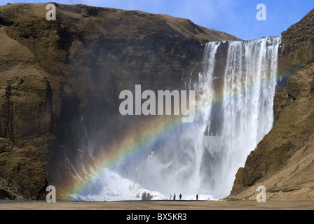 Rainbow over Skogafoss waterfall, South Iceland, Iceland, Polar Regions - Stock Photo