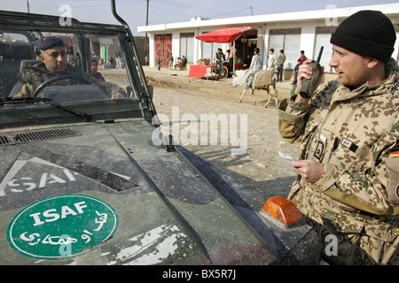Bundeswehr soldiers of the ISAF patrol on the way in a Wolf car, Mazar-e Sharif, Afghanistan - Stock Photo