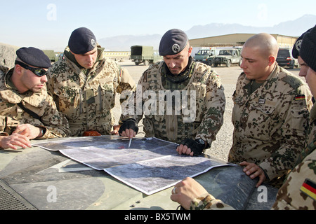 ISAF soldiers during a briefing, Mazar-e Sharif, Afghanistan - Stock Photo