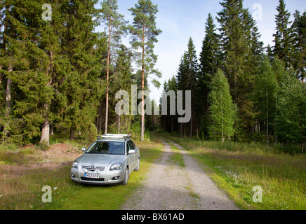 Toyota Avensis 2007 sedan diesel car parked at forest road , Finland - Stock Photo