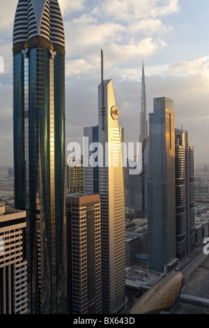 Elevated view over the modern skyscrapers along Sheikh Zayed Road looking towards the Burj Kalifa, Dubai, UAE - Stock Photo