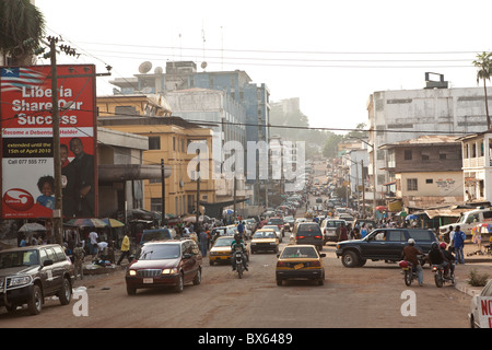 Busy city street in downtown Monrovia, Liberia, West Africa. - Stock Photo
