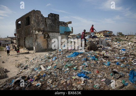City scene along oceanfront showing war damaged buildings.   Monrovia, Liberia, West Africa. - Stock Photo