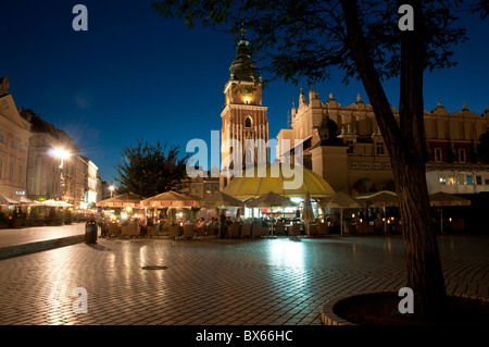 Krakow city and old town centre at night time - Stock Photo