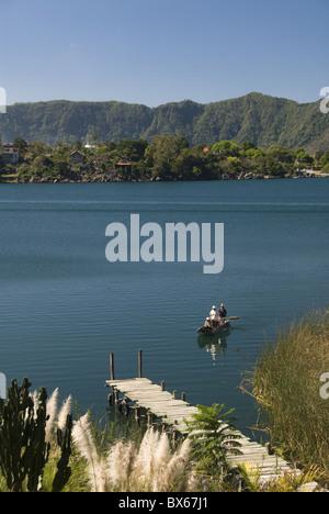 Lake Atitlan with fishermen in a small boat, near Santiago Atitlan. Guatemala, Central America - Stock Photo