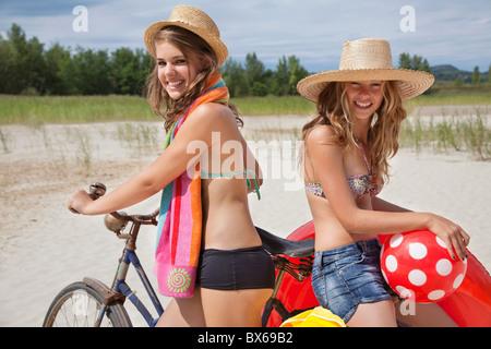 Pretty women happy on the beach - Stock Photo