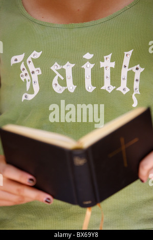 Young Christian reading the Bible, Saint-Gervais, Haute Savoie, France, Europe - Stock Photo