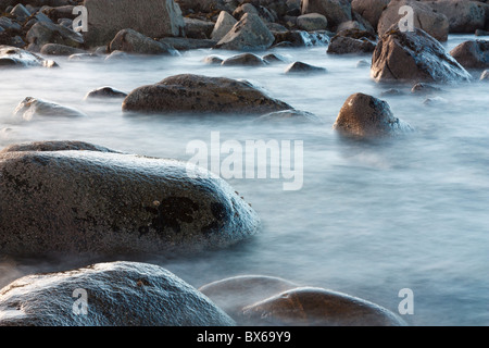 Lewisian Gneiss rocks in silky water - Stock Photo
