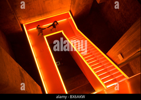 Illuminated stairwell of the former coal washery in the pit  Zollverein in Essen, Ruhr Museum today, Germany - Stock Photo