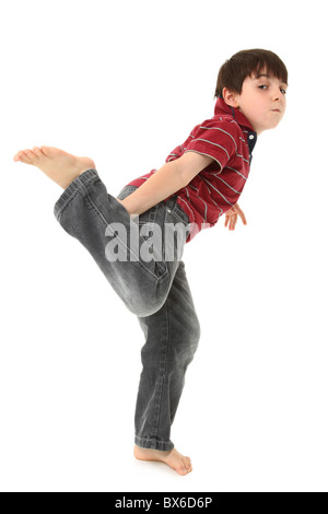 Adorable seven year old boy dancing over white. - Stock Photo