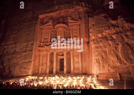 Nightime tourist show in candlelight, in front of the Treasury (El Khazneh), Petra, UNESCO World Heritage Site, - Stock Photo
