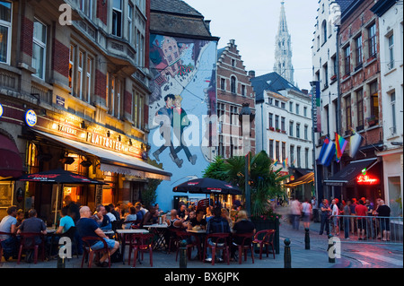 Outdoor cafes and Brousaille wall mural of a couple walking arm in arm, Brussels, Belgium, Europe - Stock Photo