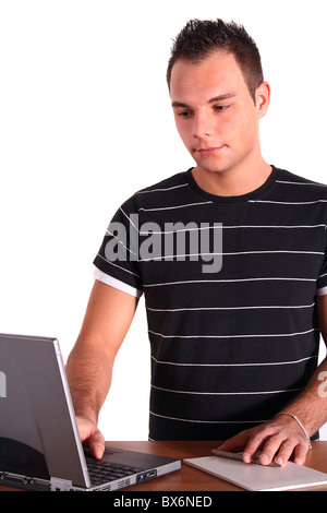An ambitious student working at his notebook computer. All isolated on white background. - Stock Photo