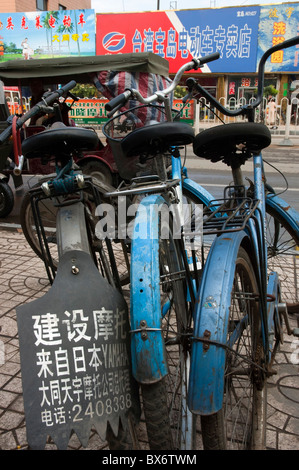 License plate on a parked bicycle lined up along a city street in Datong, Shanxi, China.