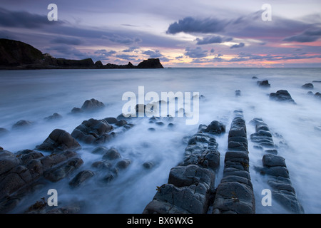 Hartland Quay at dusk from the rocky Quay Beach, North Devon, England. Autumn (September) 2010. - Stock Photo