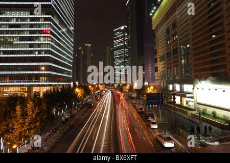 Street in Pudong at night, Shanghai China - Stock Photo
