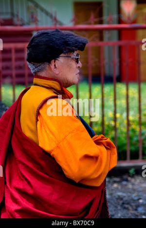 tibetan monk in traditional dress with yak fur cap,sichuan,china - Stock Photo