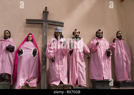 Statues of saints in indigenous attire in the Catholic Church, dating from 1571, Santiago Atitlan, Lake Atitlan, - Stock Photo