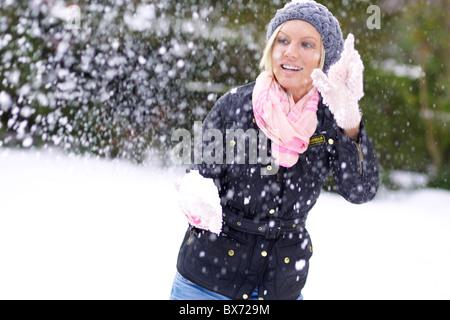 Woman in snow having fun - Stock Photo