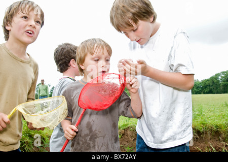 Boys fishing and catching a fish - Stock Photo