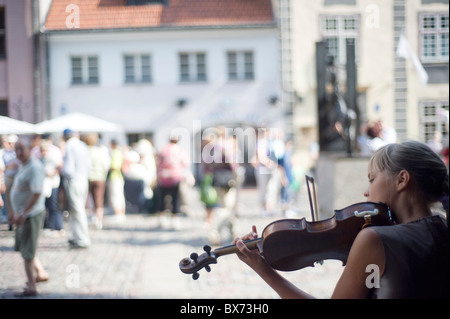 Young girl playing violin on the street of Riga - Stock Photo