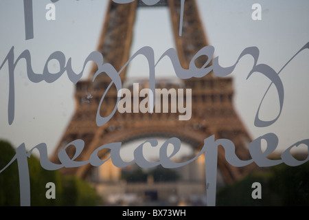 view of the eiffel tower from the champ-de-mars;The Wall for Peace, conceived by the artist Clara Halter and spatially - Stock Photo