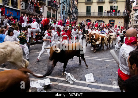 The Running of the Bulls (encierro de los toros) during the San Fermín fiesta in Pamplona, Spain. - Stock Photo