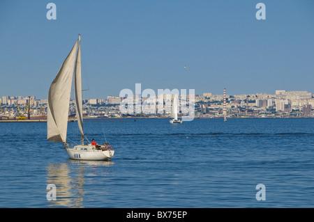 Sailing boat on Baku Bay, Baku, Azerbaijan, Central Asia, Asia - Stock Photo