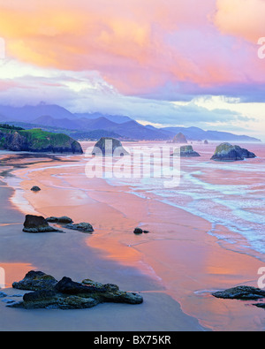Spectacular sunrise looking south from Ecola State Park over Crescent Beach towards Cannon Beach, Oregon - Stock Photo