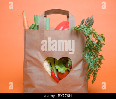 Vegetables in bag with heart symbol - Stock Photo